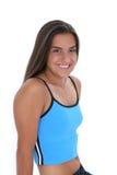 Belle fille de l'adolescence dans des vêtements de séance d'entraînement avec le long cheveu noir Images stock