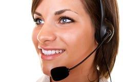 Belle fille de service à la clientèle avec l'écouteur Image libre de droits