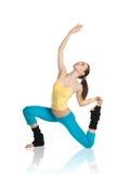 Belle fille faisant la gymnastique sur le blanc Photos libres de droits
