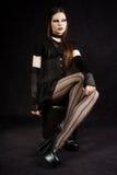 Belle fille gothique avec le renivellement de cygne Photos stock