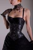 Belle fille gothique dans le corset argenté Photographie stock libre de droits