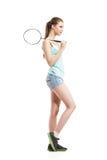Belle fille jouant avec la raquette de badminton Images stock