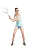 Belle fille jouant avec la raquette de badminton Photos stock