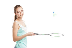 Belle fille jouant avec la raquette de badminton Photographie stock libre de droits