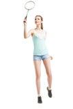 Belle fille jouant avec la raquette de badminton Photographie stock