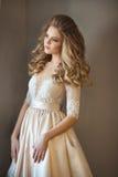 Belle fille peinte dans une robe Photographie stock