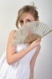 Belle fille se cachant derrière un ventilateur Images libres de droits