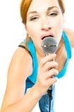 Belle fille sexuelle avec un microphone Photographie stock libre de droits