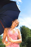 Belle fille sous le parapluie Photos stock