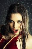 Belle fille sous une pluie Photos libres de droits