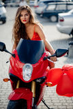 Belle fille sur la moto Photos stock