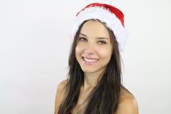 Belle fille utilisant un chapeau de Santa photographie stock