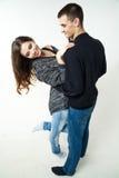Belle giovani coppie isolate su fondo bianco Immagini Stock Libere da Diritti