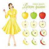 Belle girl in fifties retro dress holding apple in her hand Stock Image