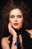 Belle jeune femme avec la coiffure magnifique photo libre de droits