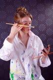 Belle jeune femme avec la peinture sur son visage Images stock