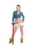 Belle jeune femme avec un marteau Images stock