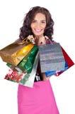 Belle jeune femme heureuse avec des sacs à provisions photos stock