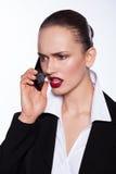 Belle jeune femme parlant au téléphone Photos stock