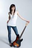 Belle jeune fille avec la guitare Image libre de droits