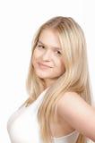 Belle jeune fille posant sur le fond blanc Photo stock