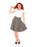 Belle jupe s'usante de jeune femme sur le blanc image libre de droits