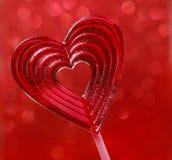 Belle lucette rouge dans la forme de coeur. Symbole de l'amour doux Images stock