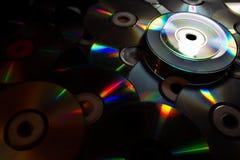 Belle lumière à de vieux disques de DVD Photographie stock