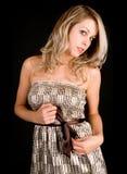 Belle Madame blonde dans une robe beige Photographie stock libre de droits