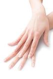 Belle mani e unghie attraversate con il manicure Fotografie Stock Libere da Diritti