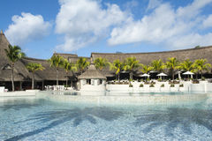 Belle Mare, Mauritius  - June 26, 2015: The LUX Belle Mare hotel pool area, Mauritius, 2015. Beautiful exterior of poolside of  LUX hotel on the tropical island Stock Images
