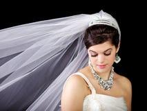 Belle mariée regardant vers le bas Image libre de droits