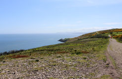 Belle mer, Howth, Dublin Bay, l'Irlande, roches, falaise et pierres Photo libre de droits