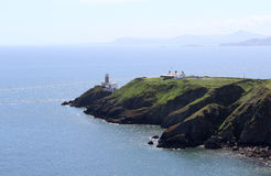 Belle mer, Howth, Dublin Bay, l'Irlande, roches, falaise et pierres Photographie stock libre de droits