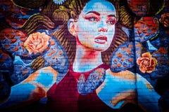 Belle peinture murale d'une femme photos libres de droits