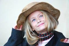Belle petite fille avec le chapeau Photo stock