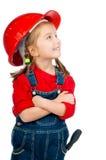 Belle petite fille dans le casque de construction image stock