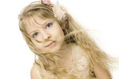 Belle petite fille sur le blanc Images stock