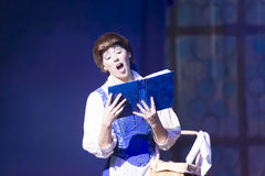 Belle Reads a book. GREEN BAY, WI - FEBRUARY 10: Bell reads a book from Beauty and the Beast at the Disney Princesses show at the Resch Center on February 10 Royalty Free Stock Photo