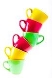 Belle tazze di colore giallo, rosso, verde Fotografia Stock