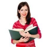 Belle étudiante affichant un livre Photos stock
