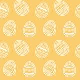 Belle uova decorate del modello senza fine sul contesto ambrato royalty illustrazione gratis
