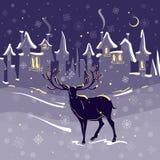 Belle ville de neige de nuit de Noël de cerfs communs Photos libres de droits