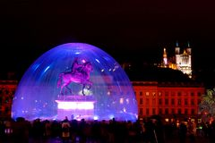 Bellecour square during light fest (Lyon, France). Bellecour square and the Fourviere hill (Lyon) with its equestrian statue of Louis XIV by the Lyons sculptor F Royalty Free Stock Photography