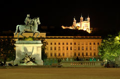 Bellecour square at night (France). Bellecour square and the Fourviere hill (Lyon) with its equestrian statue of Louis XIV by the Lyons sculptor F. Lemot Royalty Free Stock Images