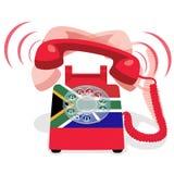 Bellende rode stationaire telefoon met roterende wijzerplaat en vlag van de Republiek Zuid-Afrika Royalty-vrije Stock Foto