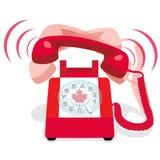 Bellende rode stationaire telefoon met vlag van Canada stock foto