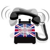 Bellende zwarte stationaire telefoon met roterende wijzerplaat en vlag van het UK Stock Afbeeldingen