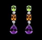Belles boucles d'oreille avec les gemmes colorées Photographie stock libre de droits