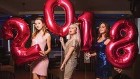 Belles filles à la partie de nouvelle année Images libres de droits